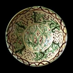 Earthenware bowl with incised decoration in a white slip and painted in green and manganese in a yellowish glaze (Bamiyan type) Afghanistan; c. 1200