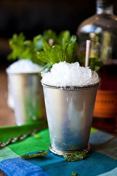 Mint Julep:  7 ounces bourbon  2 ounces mint simple syrup  25-30 mint leaves, plus more for garnish  ice cubes  crushed ice