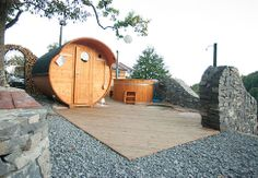 Gallery of hot tubs, barrel sauna, woodburning stoves, chimney, flues and sauna accessories.