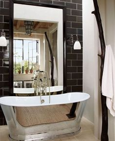 Modern and traditional at the same time! Love this winning combination of black tile and metallic #bathroom tub! #homedecor @istandarddesign #traditionalbathroom