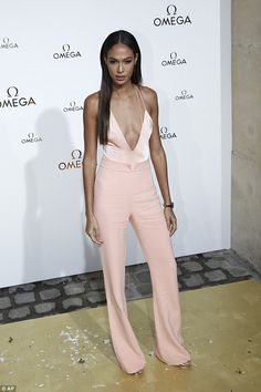 df3f54fc5e Joan Smalls goes bra-less in risqué jumpsuit at PFW s Omega party