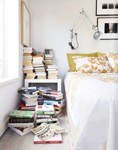 la la loving books stacked by the bed.  #mondaymess #lalaloving