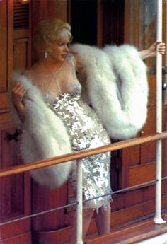 """Marilyn Monroe's dress and fur from the movie """"Some Like It Hot"""".  This dress has alot going on! I never noticed the little heart cut out on her left """"bun"""" in the back of this dress before! lol"""