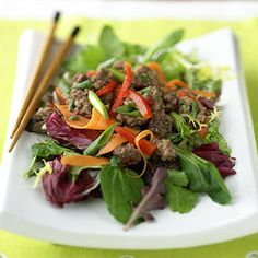 If you like the mix of warm ground beef and salad greens typical of a taco salad, why not try a Thai twist? This is an equally enticing mix of spicy meat, matchstick vegetables, and cool greens.