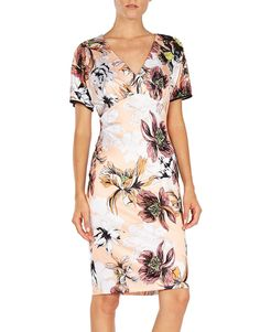 Crafted from soft jersey, this Blumarine flower-print dress features a figure hugging silhouette with short sleeves and a high waisted pencil skirt.