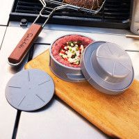Sur La Table® Deluxe Slider Set - $14.99 - comes with a mini burger basket to flip all burgers at once and keep them from falling in the grates, also comes with a burger press