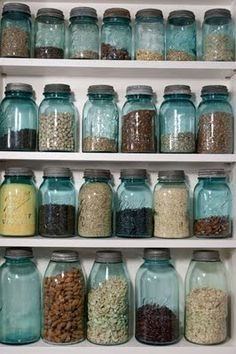 Totally going to do this Idea: Use blue ball jars for random storage (practical) and keep them on the shelf above the kitchen cupboards - they could circle the whole room (decorative).  {what i wanted to do for spices! but they were too big!!}