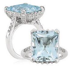 hermoso anillo con gema azul perfecto para fiestas elegantes