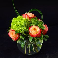 A refreshing arrangement of green hydrangea and orange roses perfect for that summer feeling! **Content of product may vary, but color and style will remain the same**
