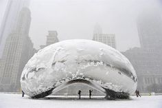 """Anish Kapoor's sculpture """"Cloud Gate"""" is covered in snow on March 2013 in Chicago, Illinois. The worst winter storm of the season was expected to dump inches of snow on the Chicago area. (Photo: Brian Kersey / Getty Images via NBC News) Oh The Places You'll Go, Places To Travel, Chicago Snow, Chicago Winter, Magic Places, Instalation Art, My Kind Of Town, Travel Tips, Places"""