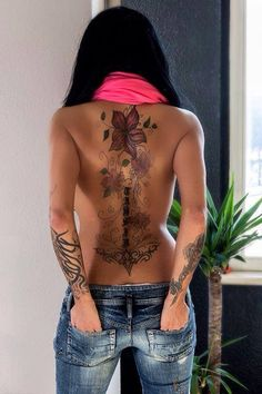 Love the placement and size of the back tattoo. I would just be doing an all black, lace tattoo though.