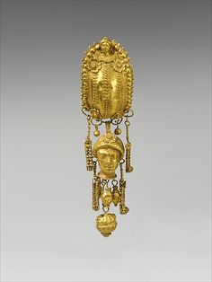 Earring with pendants and female head   Period: Hellenistic Date: 3rd century B.C. Culture: Etruscan Medium: Gold, silver