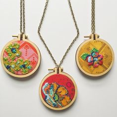 Embroidery hoop necklaces by Wildboho