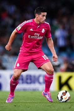 James Rodriguez of Real Madrid CF runs with the ball during the La Liga match between Real Sociedad de Futbol and Real Madrid CF at Estadio Anoeta on August 31, 2014 in San Sebastian, Spain.
