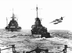 He 115 aircraft performing a low fly-by of German warships, date and location unknown