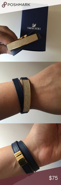 Swarovski Vio Bracelet in Navy and Gold Great condition - like new! Worn two times. Navy blue leather band with gold and white crystals. Size medium. Comes with box Swarovski Jewelry Bracelets