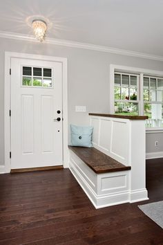 Separate the entry and living room with a bench to also serve as a half wall to rest furniture against on the other side