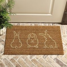 Hop on this fun 3 Bunnies Coir Mat before they're all gone. The adorable bunny silhouettes were created by our own in-house artist. Hand woven of natural coco fibers and hand stenciled using fade-resistant dyes.3 Bunnies Coir Mat features:Great scrape-abilityVinyl-backed for added durabilityRecommended for use in covered outdoor areasImported