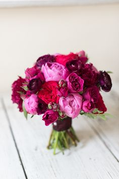Inspiration for bridesmaids bouquets - darker raspberry colors.