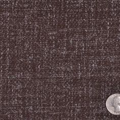 This is a medium weight, wiry, wool tweed with speckled fibers instead of colorful slubs. Good for suiting.