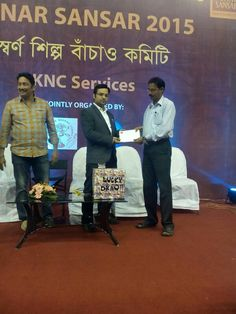 Giving prize to winner at Sonar Sansar jewellery exhibition