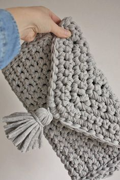 Handmade Bag, Chunky Knit Bag, Girlfriend Gift, Party Bag, Evening Bag, Boho Handbag, Festival Bag, Handmade clutch bag, Handmade purse, This heavily textured chunky knit crochet clutch bag is knitted from t shirt yarn making it a great gift for the stylish woman in your life & an essential boho accessory for Festivals or the beach this spring and summer. Measuring 13 x 10 inches it is sized to fit most 7 or 10 tablets and is the perfect size for your phone, make up, keys and other esse...