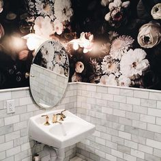 Bathroom with floral wallpaper and marble tile