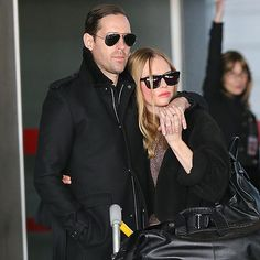 Shady lovers Michael Polish and Kate Bosworth snuggled up after arriving in Paris! Aviators for him and modernized wayfarers for her!