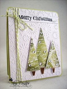 Dry embossed background; Hero Arts stamps; trees white embossed & then colored with distress Inks