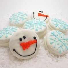 snowflake and snowman on white chocolate oreo cookies