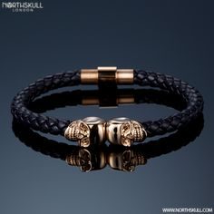 Perfect For Both Formal & Casual Styles Our Sleek Navy Blue Nappa Leather/ 18kt. Rose Gold Twin Skull Bracelet Exudes Elegance | Available Now At Northskull.com [Worldwide Shipping] #northskull #Jewelry #bracelet #rose #mensstyle #fashion #gold #navy #skulls #luxury