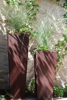 Whether on their own or nestled amongst other planters, these just seems to fit. Clean, contemporary lines with handmade integrity. We paired these beauties with fresh grasses and hardy sedum to add balance and softness. Both planters have natural rust patina finish, a unique characteristic of corten steel.