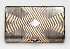 Russian cigarette case. Silver, gold, sapphire. Given to George V, as Duke of York, by Mary, Duchess of York, 1896.