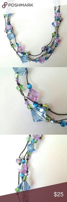 "Dabby Reid Crystal Necklace, Signed, 3 Strand Dabby Reid 3 strand faceted crystal necklace. Purple, blue and green crystals with accent beads. Designer signed. Measures about 15"" including the lobster clasp. Has a 2 1/2"" extender chain. Looks great on. Dabby Reid Jewelry Necklaces"
