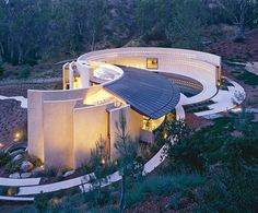 """Wing House, near Rancho Santa Fe, California, was designed by architect and designer Wallace E. Cunningham. """"The subtle curvature of the surrounding topography is reflected in the design, which encourages constant movement from one space to another, from interior to exterior,"""" Inside the World's Greatest Homes : Architectural Digest"""