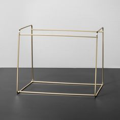 Give your home office space a style and functionality update with this Metal Hanging File Holder from Hearth & Hand™ with Magnolia. This sturdy and durable metal hanging file organizer features a shiny gold design for a touch of style, with one large slot for keeping folders holding for crafting paper organized. The simple and attractive design of this gold metal desk organizer makes it perfect for displaying on a shelving unit or on a desktop so you can easily find and access yo...