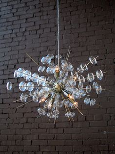 "This lovely chandelier features a bubble design with an antique brass finish. The chandelier measures 25"" - 36"" in diameter and comes with 10 feet of cable and a 7"" diameter ceiling plate. It takes 25"