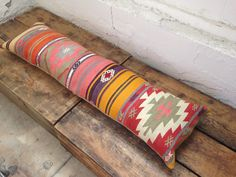 """Our signature 4' bed cushion in a subtle palette. No waiting on this one - it's ready to ship! Kilim front, heavy-duty neutral backing fabric, removable feather-down insert. 12""""x48"""". Your bed will thank you! Ships within 5-7 business days. Spot-clean."""