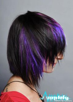 A short to medium hairstyle with extreme texture. This haircut is brought to life with panels of purple and blue haircolor.