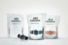 """Techniques : Le packaging est plus difficile à transporter qu'un packaging classique d'une montre.  Communication : On voit le logo Festina et le slogan pour cette montre """" engineered for water"""" écrit avec un style épuré et design. La montre est insérée dans une poche d'eau pour démontrer au consommateur que celle-ci est Waterproof. L'information transmise au consommateur est donc directe et vérifiée au travers du packaging. L'impact visuel est donc important."""