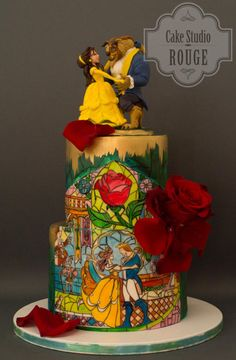 This Beautiful Beauty and the Beast Cake has a painting of the stained glass window in Be Our Guest at Walt Disney World and has Belle and the Beast dancing on top.