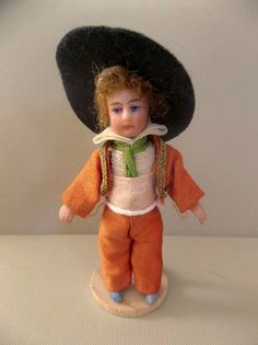 Offered is  Vaquero  Español (Spanish Cowboy) Lilliputian (also referred to as lilliputians) Doll , this Tiny Doll measures approximately 2-1/2 tall,