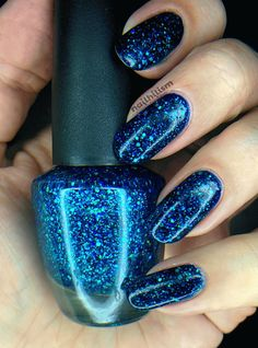 "Star Kin ""Mariana"" - deep blue jelly with navy, blue and teal holo glitter. Opaque in two coats"