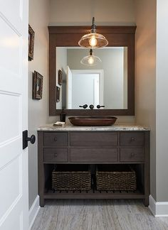 Modern farmhouse style in all its glory with this furniture style vanity and copper pedestal sink.