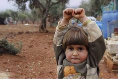 """Syrian girl thought the photojournalist was holding a weapon, so she """"surrendered"""". Such a sad world we live in."""