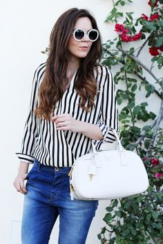 a black and white strepes shirt for a casual chic outfit with round sunglasses and a white prada bag  Outfit the fashion blogger Irene's Closet www.ireneccloset.com