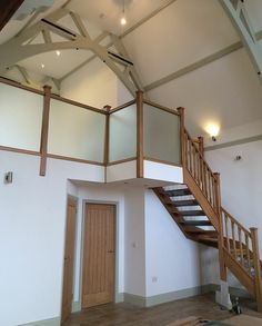 This oak staircase with frosted glass landing balustrade looks great with the oak spindles!