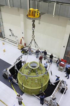 https://flic.kr/p/NVa1tG | KSC-20161116-PH-JBS01_0026 | Inside the Neil Armstrong Operations and Checkout Building at NASA's Kennedy Space Center in Florida, Lockheed Martin technicians attach lines from a crane to the Orion crew module structural test article (STA). The STA arrived aboard NASA's Super Guppy aircraft at the Shuttle Landing Facility operated by Space Florida. The test article will be lifted out of its container and moved to a test tool called the birdcage for further…