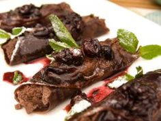 Bobby Flay's Chocolate Blintzes with Chocolate Whipped Ricotta-Almond Filling and Warm Cherry Sauce