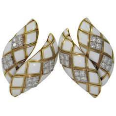 One pair of 18K yellow gold earrings using white enamel to give a soft quilted appearance. In four platinum sections are set a total of 16 round brilliant cut diamonds weighing 1ct total approximate weight. Diamonds are of overall F/G color and VS1 clarity. Late 20th Century